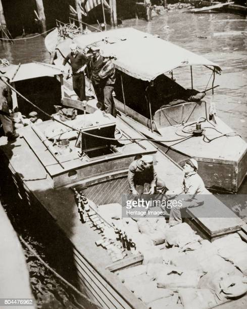 A rumrunning boat caught smuggling in 2000 bottles USA 1920s The sale manufacture and transportation of alcohol for consumption were banned in the...