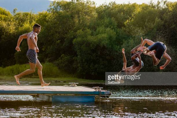 run and jump - somersault stock pictures, royalty-free photos & images
