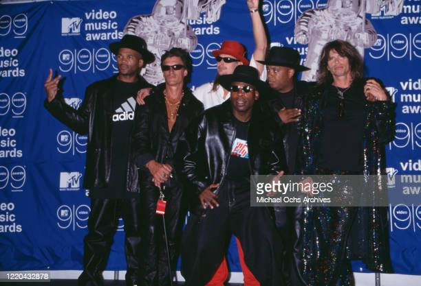 Run DMC and Kid Rock with Steven Tyler and Joe Perry of Aerosmith backstage at the 1999 MTV Music Video Awards, held at the Metropolitan Opera House,...
