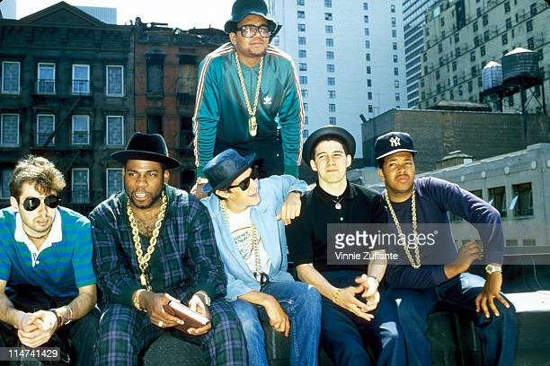 Run DMC and The Beastie Boys on a rooftop in Hell's Kitchen NYC announcing a Coheadlining tour in the summer of 1985