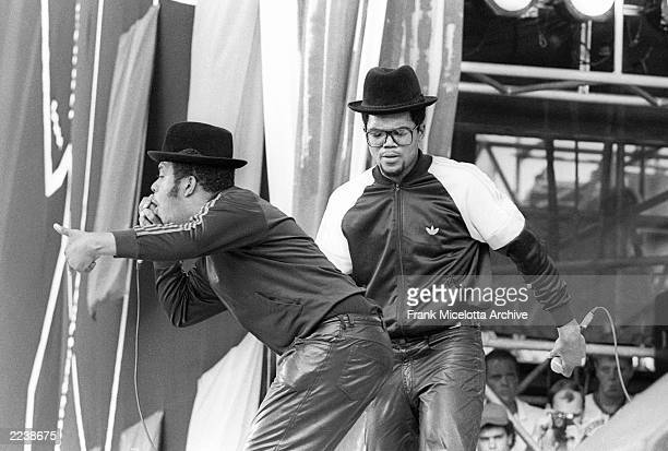 Run DMC performs for a sold out crowd at the Live Aid concert at JFK Stadium in Philadelphia Pennsylvania July 13 1985 Photo by Frank...