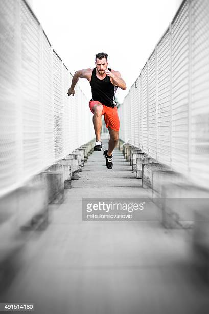 run. fast. - forward athlete stock pictures, royalty-free photos & images
