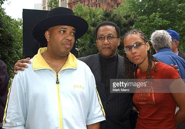 Run from hip hop group Run DMC Minister Benjamin Chavez Muhammad and singer Alicia Keys attend the Mobilization for Education Hip Hop Summit Action...