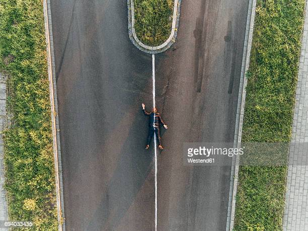 run over man lying on road - roadkill stock photos and pictures