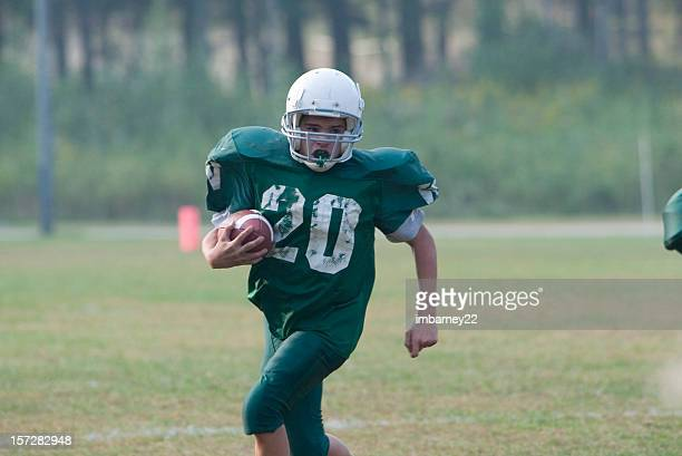run the ball - halfback american football player stock pictures, royalty-free photos & images