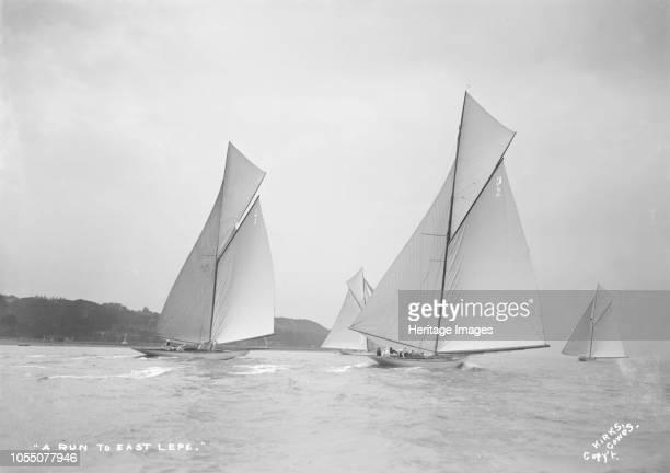 the 15metre 'Ostara' 'Mariska' and 19metre 'Corona' 'Octavia' run downwind 1911 Artist Kirk Sons of Cowes