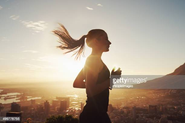 run with the sun - sportsperson stock pictures, royalty-free photos & images
