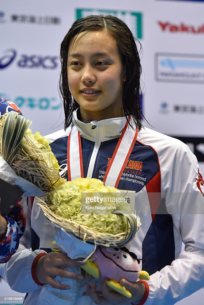 Runa Imai (Bronze) poses for pgotographs on the podium after the Women's 200m Breaststroke final during the Japan Swim 2016 at Tokyo Tatsumi International Swimming Pool on April 9, 2016 in Tokyo, Japan.