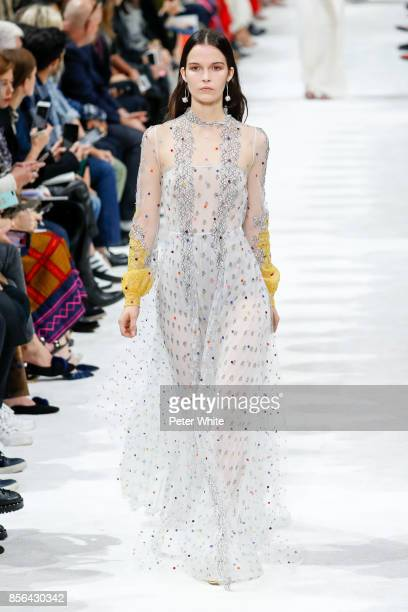 Runa Neuwirth walks the runway during the Valentino show as part of the Paris Fashion Week Womenswear Spring/Summer 2018 on October 1 2017 in Paris...