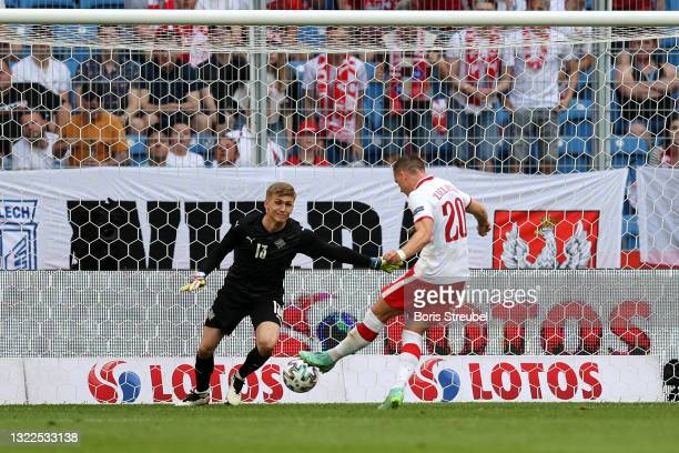Runar Alex Runarsson of Iceland fails to save a shot from Piotr Zielinski of Poland who scores his teams first goal during the international friendly...
