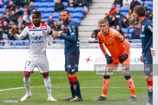 Runarsson Runar Alex of Dijon and Cornet Maxwel of Lyon and Marie Jordan of Dijon during the Ligue 1 match between Lyon and Dijon at Groupama Stadium...