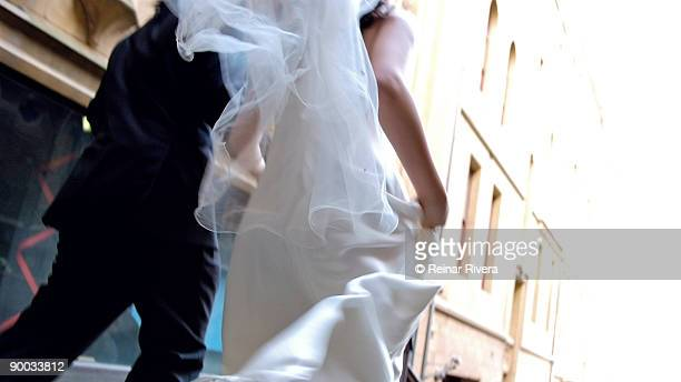 runaway bride  - wedding veil stock photos and pictures