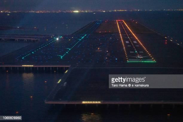 'D' runaway of Tokyo Haneda International Airport night aerial view from airplane