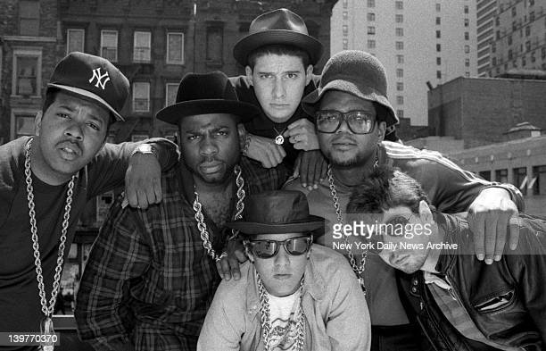 RunDMC and The Beastie Boys get it together on roof of BSmith's restaurant at Eighth Ave 47th St at press conference DJ Run Jam Master Jay King...