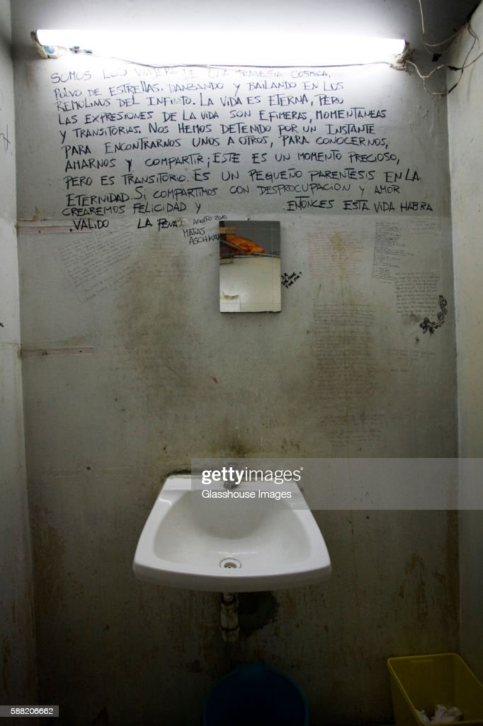 rundown bathroom with sink and writing on wall stock photo getty rh gettyimages com