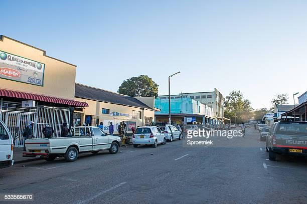 run-down shops in downtown kwekwe, zimbabwe - zimbabwe stock pictures, royalty-free photos & images