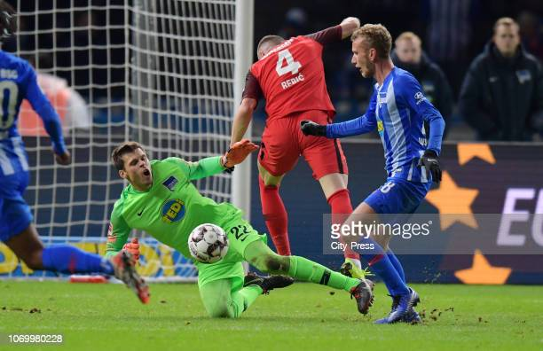 Rune Almenning Jarstein of Hertha BSC Ante Rebic of Eintracht Frankfurt and Fabian Lustenberger of Hertha BSC during the game between Hertha BSC and...
