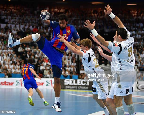 Rune Dahmke of Kiel challenges Cedric Sorhaindoof Barcelona during the EHF Champions League Quarter Final first leg match between THW Kiel and...