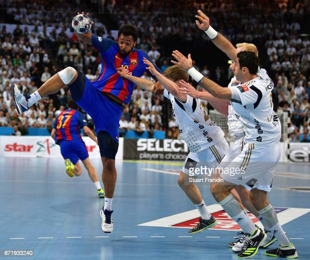 Rune Dahmke of Kiel challenges Timothey N'Guessan of Barcelona during the EHF Champions League Quarter Final first leg match between THW Kiel and...