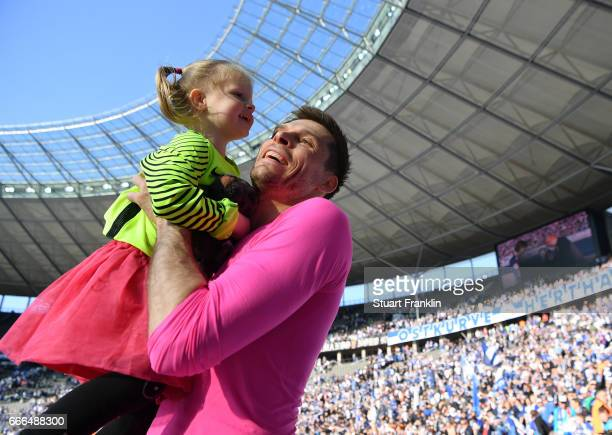 Rune Jarstein of Berlin celebrates with his daughter after during the Bundesliga match between Hertha BSC and FC Augsburg at Olympiastadion on April...