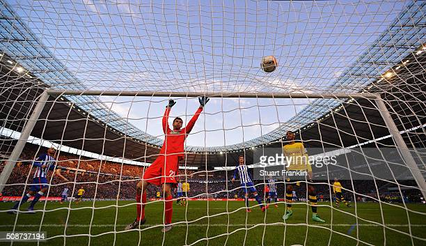 Rune Jarstein of Berlin watches a shot go over the bar during the Bundesliga match bewteen Hertha BSC and Borussia Dortmund at Olympiastadion on...