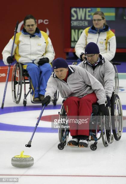 Rune Lorentsen of Norway releases the stone during the Wheelchair Curling bronze medal match between the Sweden and Norway on day seven of the Turin...