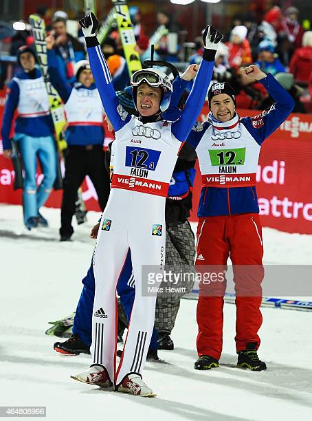 Rune Velta and Anders Jacobsen of Norway celebrate after winning the gold medal in the Men's Team HS134 Large Hill Ski Jumping during the FIS Nordic...