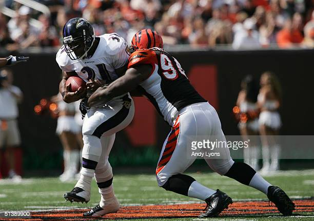 Runing back Jamal Lewis of the Baltimore Ravens evades defensive tackle Tony Williams of the Cincinnati Bengals during the game at Paul Brown Stadium...