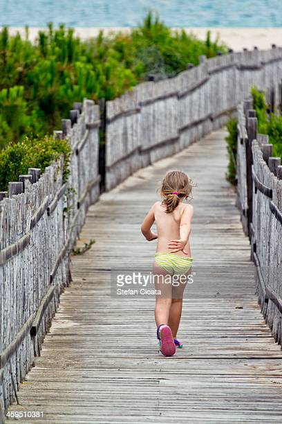runing to the beach - one girl only stock photos and pictures