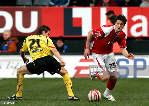 Runing with the ball Greg Halford of Charlton Athletic passes by Tommy Smith of Watford during the Charlton Athletic v Watford Coca Cola Championship...