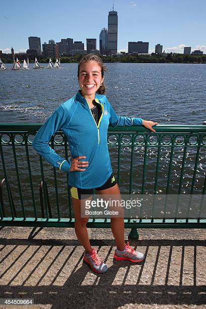 Runner Abbey D'Agostino stands against the Boston Skyline Photo by Jonathan Wiggs/The Boston Globe via Getty Images