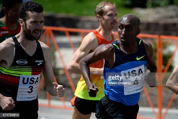 USA runner Abdi Abdirahman checks out countryman Bobby Curtis during the Bolder Boulder People competed in the annual 10k road race on Monday May 25...