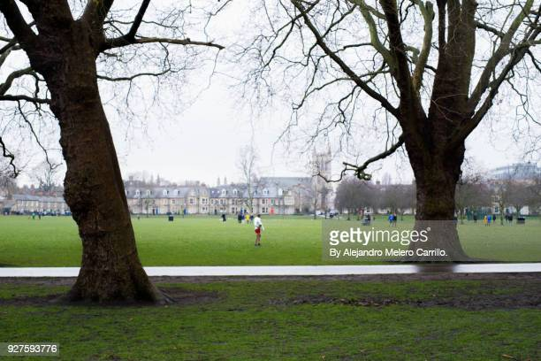 runner after race walks in by a park. - day of the week stock pictures, royalty-free photos & images