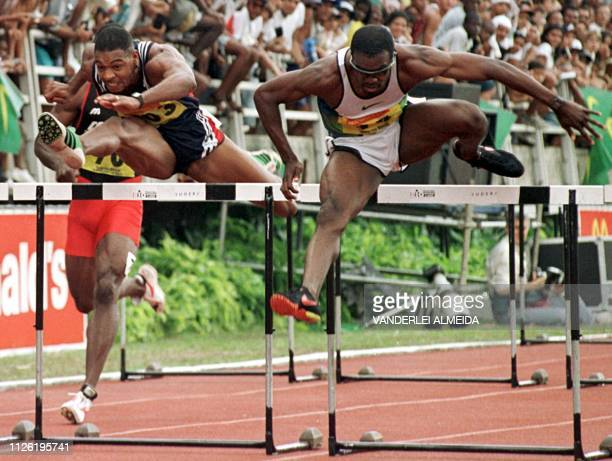 US runner Allen Johnson dispute the last meters of the 100m hurdles race followed by Cuban Anier Garcia 04 May during the Brazilian Grand Prix...