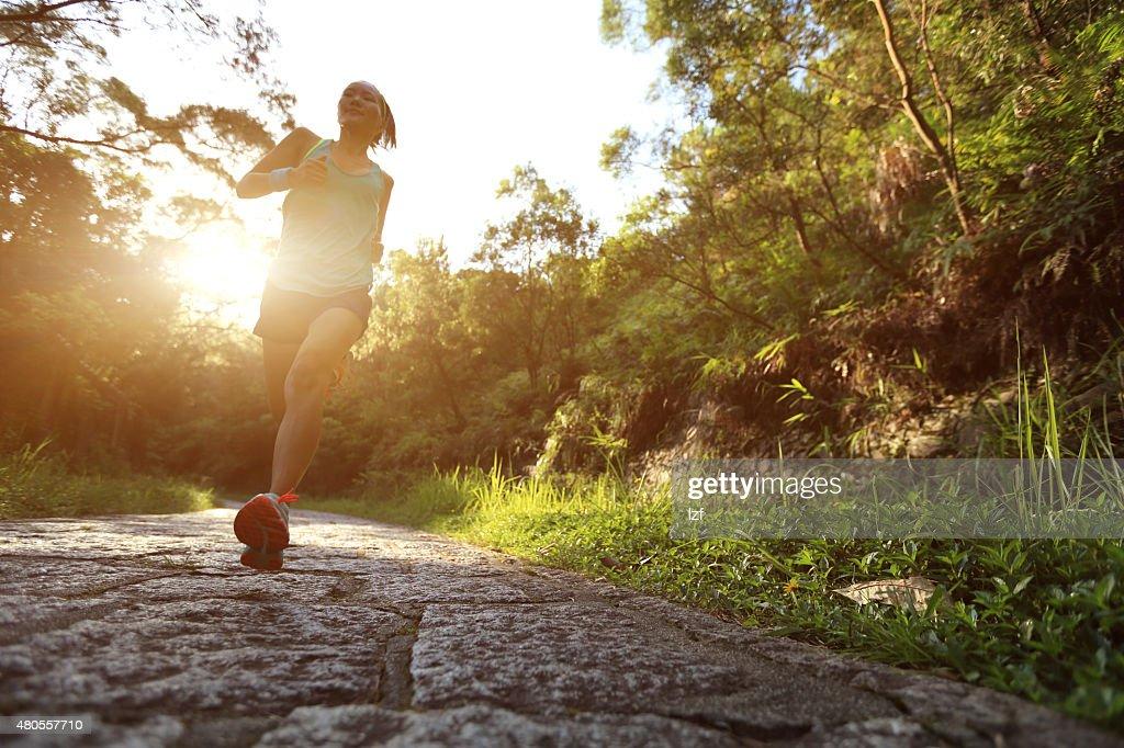 Runner athlete running on forest trail. : Stock Photo