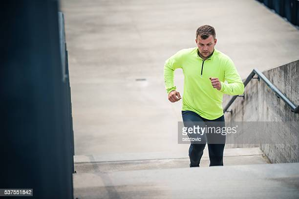 Runner athlete running on stairs