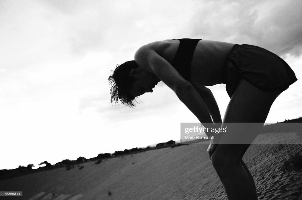 Runner bending over : Stock Photo