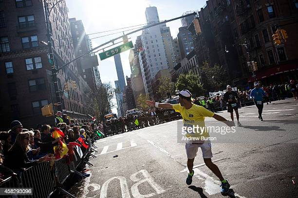 A runner blows a kiss to the crowd during the TCS New York City Marathon on November 2 2014 in New York City