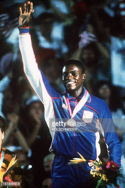 US runner Carl Lewis waves to crowd from the podium after winning gold in the 100m Men's final Los Angeles Olympic games 08 August 1984 Sam Graddy...