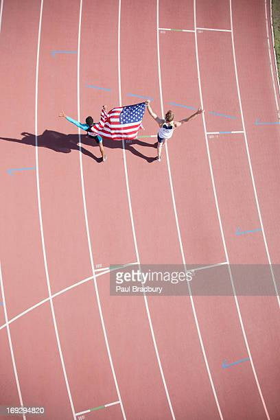 runner celebrating on track with american flag - lap of honour stock pictures, royalty-free photos & images