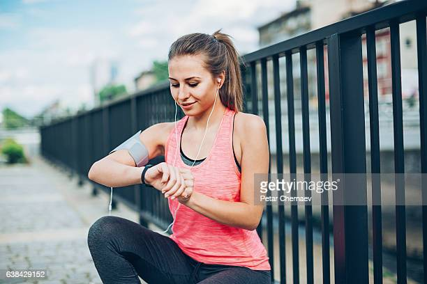 Runner checking her smart watch
