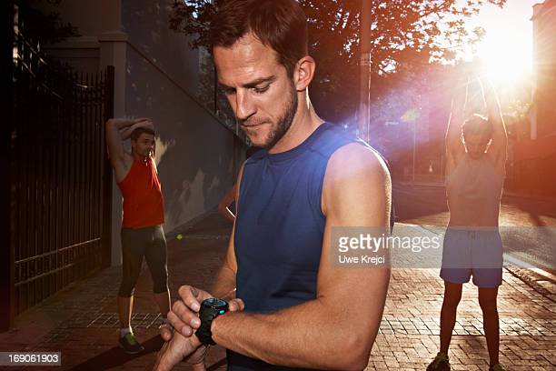 Runner checking his watch