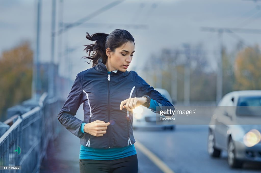 Runner checking time : Stock Photo