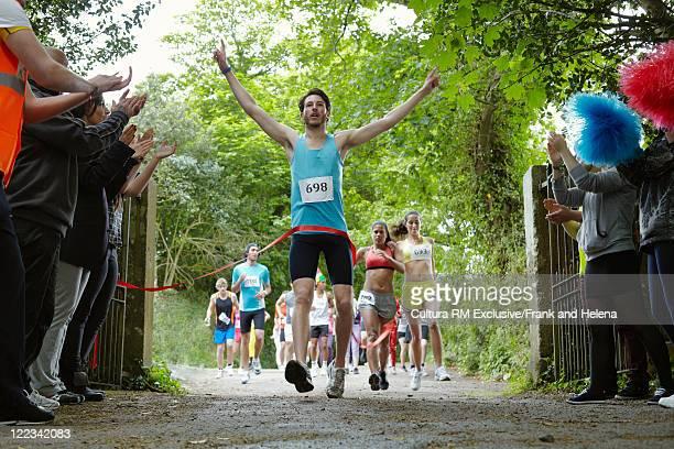 Runner cheering and finishing a marathon