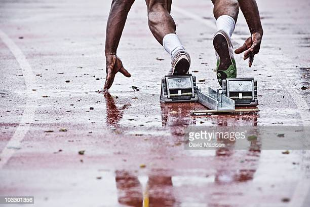 Runner coming out of starting blocks