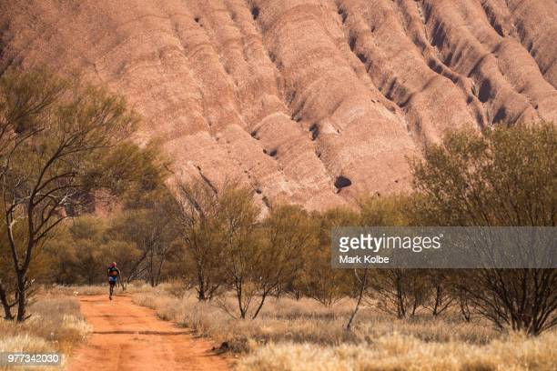 A runner competes during the Uluru Relay Run as part of the National Deadly Fun Run Championships on June 16 2018 in Uluru Australia The annual...