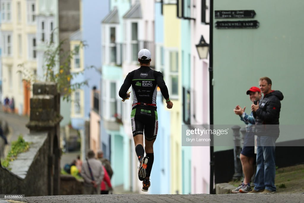 A runner competes in the bike leg of IRONMAN Wales on September 10, 2017 in Tenby, Wales.