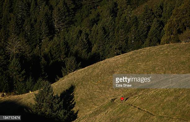 A runner competes in the GORETEX 50 Mile Race in The North Face Endurance Challenge on December 3 2011 in San Francisco California The 50 mile race...