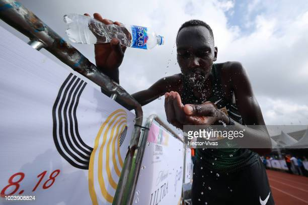 A runner cools himself the Mexico City Telcel Marathon 2018 on August 26 2018 in Mexico City Mexico