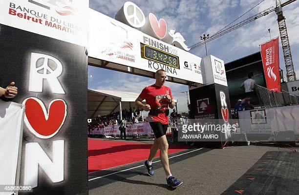 A runner crosses the finish line during the 2014 Beirut Marathon on November 9 2014 in the Lebanese capital AFP PHOTO/ANWAR AMRO